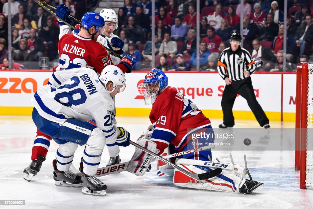 Connor Brown #28 of the Toronto Maple Leafs gets the puck past goaltender Charlie Lindgren #39 of the Montreal Canadiens in the third period during the NHL game at the Bell Centre on November 18, 2017 in Montreal, Quebec, Canada. The Toronto Maple Leafs defeated the Montreal Canadiens 6-0.