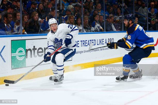 Connor Brown of the Toronto Maple Leafs looks to pass the puck against Joel Edmundson of the St Louis Blues at Scottrade Center on November 4 2017 in...