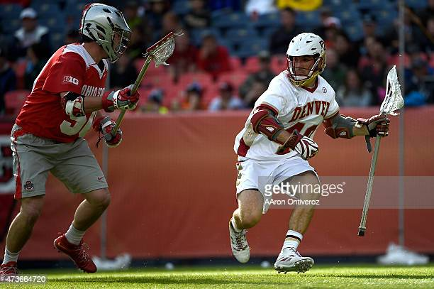 Connor Cannizzaro of the Denver Pioneers is defended by Robby Haus of the Ohio State Buckeyes during the first half of their NCAA tournament...