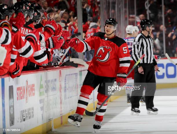 Connor Carrick of the New Jersey Devils celebrates his game winning goal against the New York Rangers at Prudential Center on April 01 2019 in Newark...