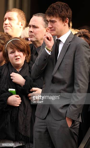 Connor Chant , the son of Warrant Officer Darren Chant, grieves as his father's coffin is carried out of the Guards Chapel on the Wellington Barracks...