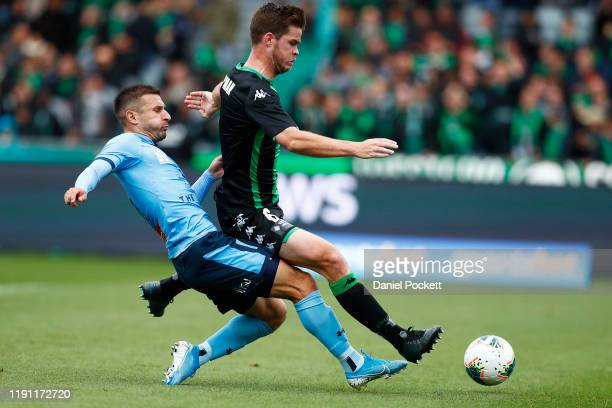Connor Chapman of Western United and Kosta Barbarouses of Sydney FC contest the ball during the round eight A-League match between Western United and...