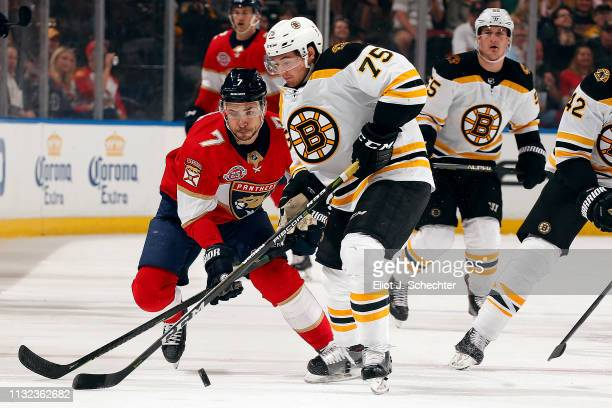 Connor Clifton of the Boston Bruins crosses sticks with Colton Sceviour of the Florida Panthers at the BBT Center on March 23 2019 in Sunrise Florida