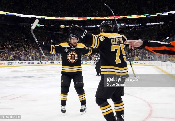Connor Clifton of the Boston Bruins is congratulated by his teammate Matt Grzelcyk after scoring a second period goal against the St. Louis Blues in...