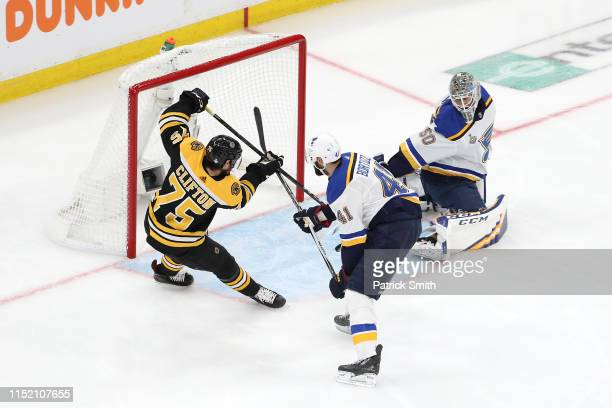 Connor Clifton of the Boston Bruins scores a second period goal past Jordan Binnington of the St Louis Blues with Robert Bortuzzo on defense in Game...