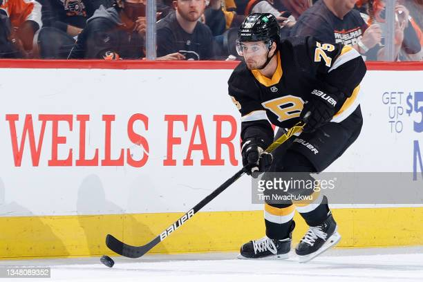 Connor Clifton of the Boston Bruins skates with the puck against the Philadelphia Flyers at Wells Fargo Center on October 20, 2021 in Philadelphia,...