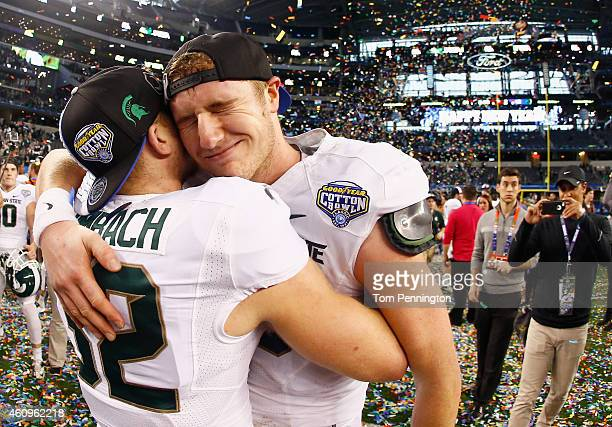 Connor Cook of the Michigan State Spartans celebrates with Zac Leimbach of the Michigan State Spartans after the Spartans beat the Baylor Bears 42-41...
