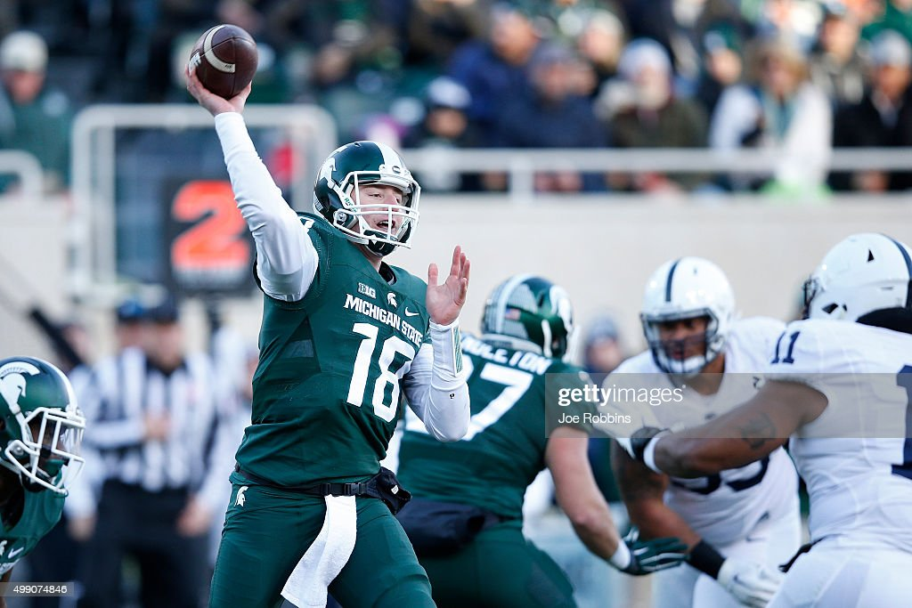 Connor Cook #18 of the Michigan State Spartans passes against the Penn State Nittany Lions in the first half of the game at Spartan Stadium on November 28, 2015 in East Lansing, Michigan.