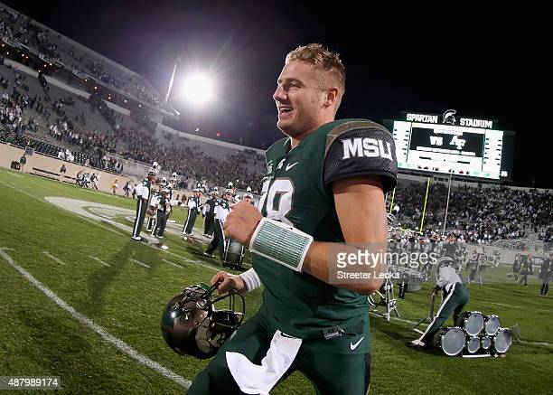 Connor Cook of the Michigan State Spartans reacts after defeating the Oregon Ducks 31-28 at Spartan Stadium on September 12, 2015 in East Lansing,...
