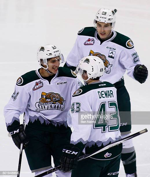 Connor Dewar of the Everett Silvertips celebrates his goal against the Vancouver Giants with teammates Lucas Skrumeda and Cole MacDonald during the...