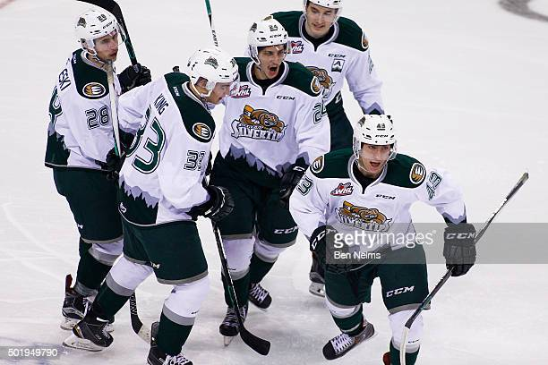 Connor Dewar of the Everett Silvertips celebrates his goal against the Vancouver Giants with teammates Devon Skoleski Brian King Lucas Skrumeda and...