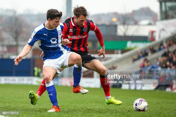 Connor Dimaio of Chesterfield and Alex Rodman of Shrewsbury Town during the Sky Bet League One match between Chesterfield and Shrewsbury Town at...