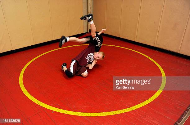 Connor Eise age 7 flips his opponent drew Eller age 8 during the Wednesday night workout The Parker Sons of Thunder elite wrestling program worked...