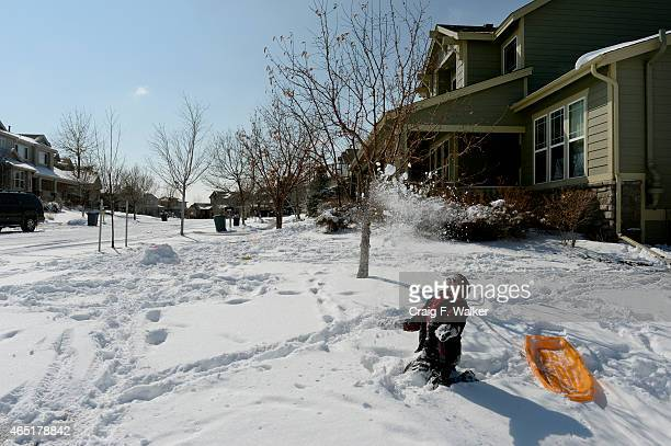 Connor Ellsworth plays in the snow outside his home in the Reunion community of Commerce City, CO February 26, 2015.