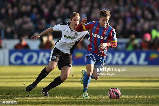 Connor Essam of Dover challenges Dwight Gayle of Palace during the FA Cup Third Round match between Dover Athletic and Crystal Palace on January 4...