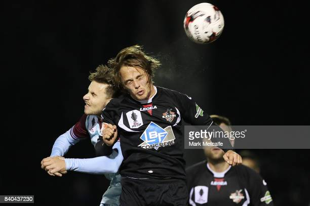 Connor Evans of Blacktown City heads the ball during the round of 16 FFA Cup match between Blacktown City and APIA Leichhardt Tigers at Lily Homes...