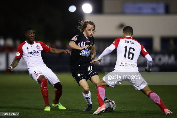 Connor Evans of Blacktown City is challenged by Roly Bonevacia and Jaushua Sotirio of the Wanderers during the FFA Cup Quarterfinal match between...