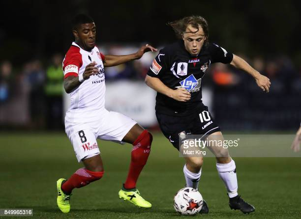 Connor Evans of Blacktown City is challenged by Roly Bonevacia of the Wanderers during the FFA Cup Quarterfinal match between Blacktown City and the...