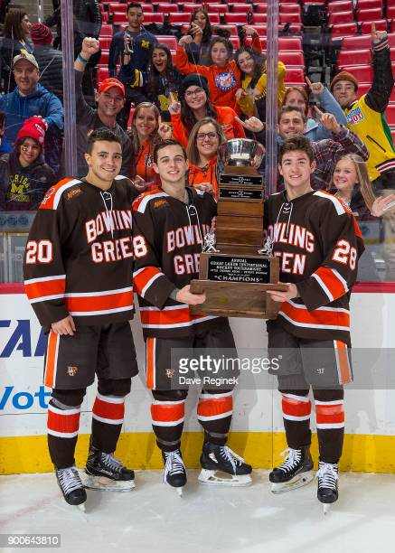 Connor Ford Brett D'Andrea and Brandon Kruse of the Bowling Green Falcons pose for a picture with the John MacInnes Cup after the championship game...