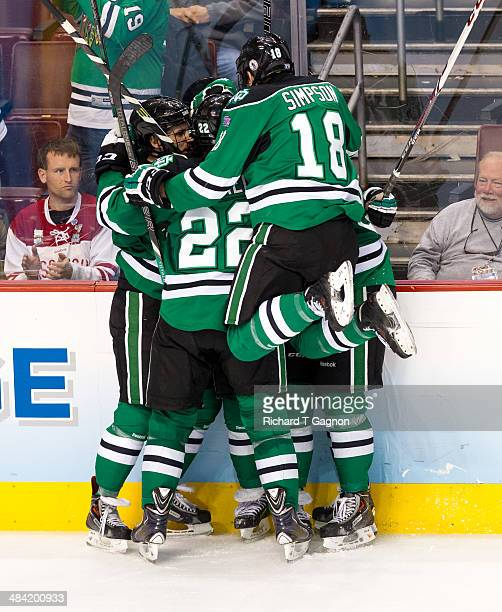 Connor Gaarder of North Dakota celebrates his goal against the Minnesota Golden Gophers with teammates Jordan Schmaltz Andrew Panzarella Dillon...