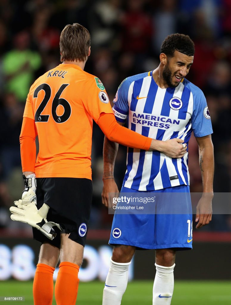 Connor Goldson of Brighton and Hove Albion and Tim Krul of Brighton and Hove Albion embrace after the Carabao Cup Third Round match between AFC Bournemouth and Brighton and Hove Albion at Vitality Stadium on September 19, 2017 in Bournemouth, England.