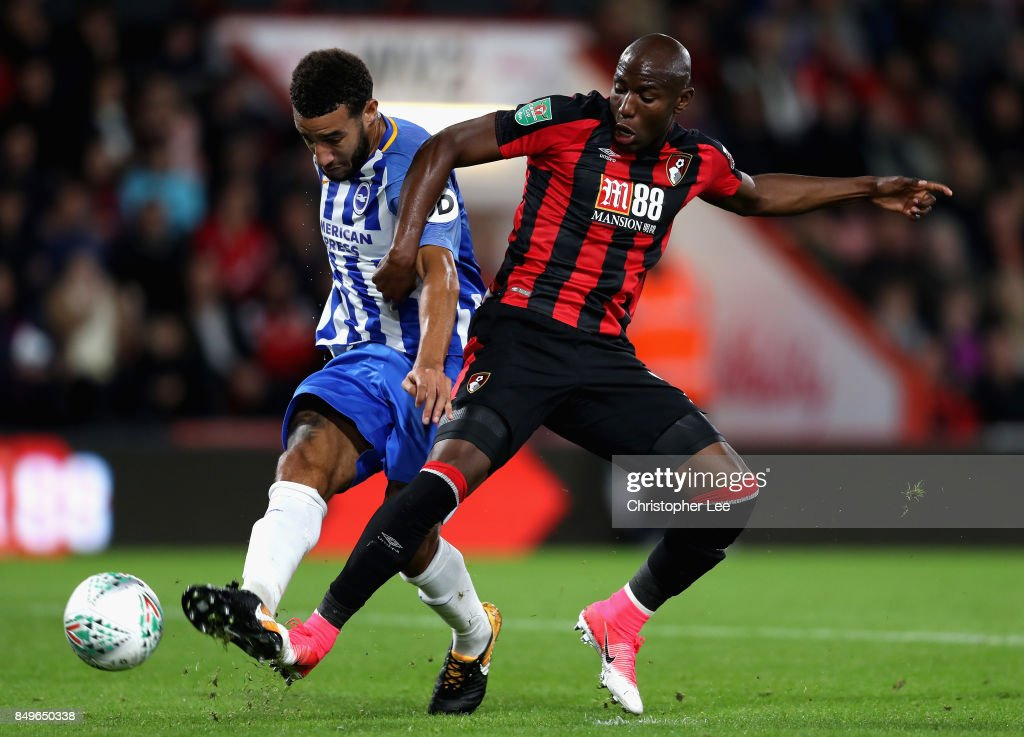 Connor Goldson of Brighton and Hove Albion shoots while under pressure from Benik Afobe of AFC Bournemouth during the Carabao Cup Third Round match between AFC Bournemouth and Brighton and Hove Albion at Vitality Stadium on September 19, 2017 in Bournemouth, England.