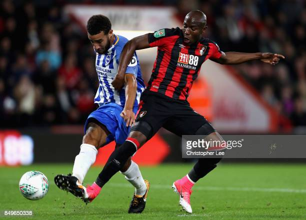Connor Goldson of Brighton and Hove Albion shoots while under pressure from Benik Afobe of AFC Bournemouth during the Carabao Cup Third Round match...