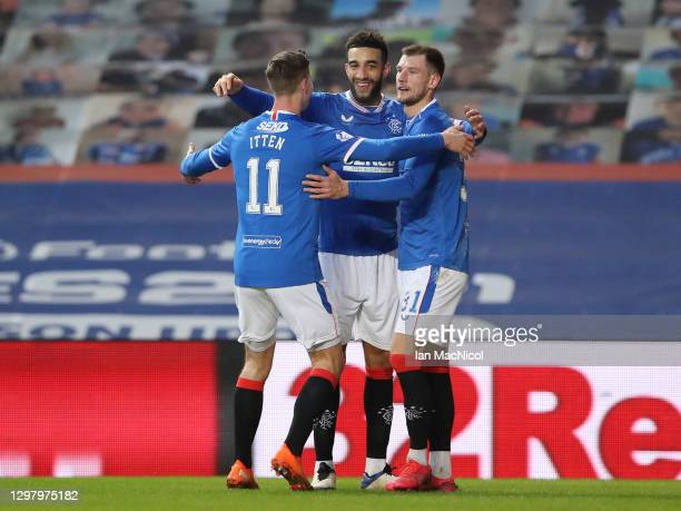 Connor Goldson of Rangers celebrates with team mates Cedric Itten and Borna Barisic after scoring their side's fifth goal during the Ladbrokes...
