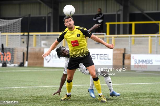 Connor Hall of Harrogate Town battles for possession with Kabongo Tshimanga of Boreham Wood during the Vanarama National League Play-Off Semi-final...