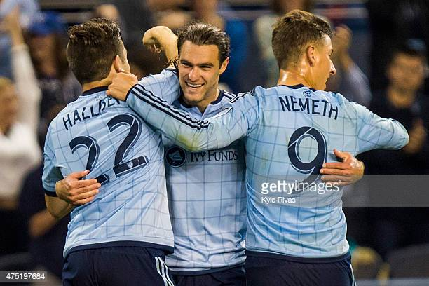 Connor Hallisey and Krisztian Nemeth surround Graham Zusi of Sporting KC after he scored the fourth goal of the game of the game in the second half...