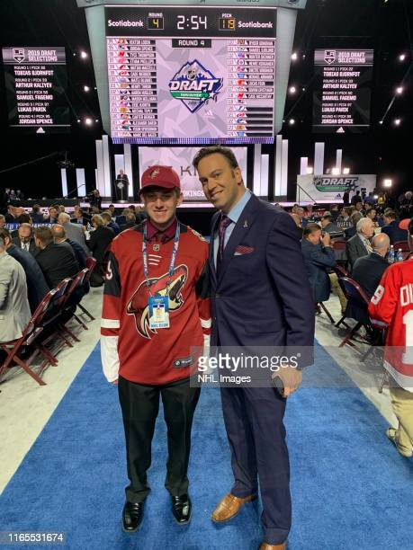 Connor Havens and Elliotte Friedman pose for a photo during Rounds 27 of the 2019 NHL Draft at Rogers Arena on June 22 2019 in Vancouver Canada...