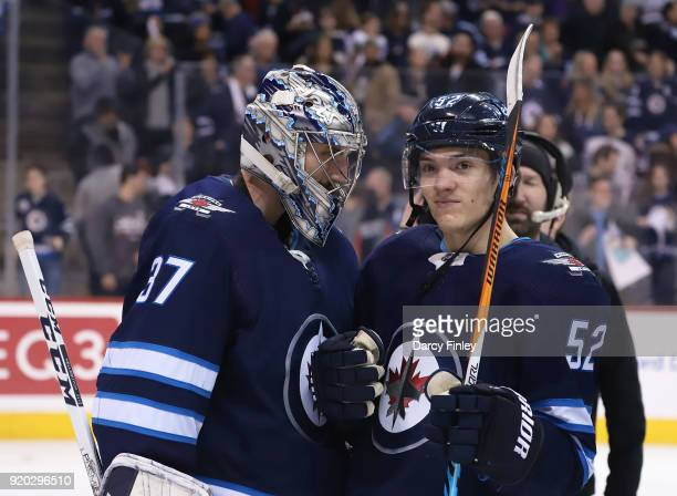 Connor Hellebuyck and Jack Roslovic of the Winnipeg Jets celebrate following a 72 victory over the Florida Panthers at the Bell MTS Place on February...