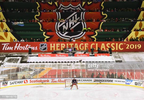 Connor Hellebuyck follows the play in the third period against the Calgary Flames during the 2019 Tim Hortons NHL Heritage Classic at Mosaic Stadium...