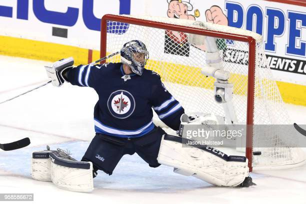 Connor Hellebuyck of the Winnipeg Jets allows a first period goal to Tomas Tatar of the Vegas Golden Knights in Game Two of the Western Conference...