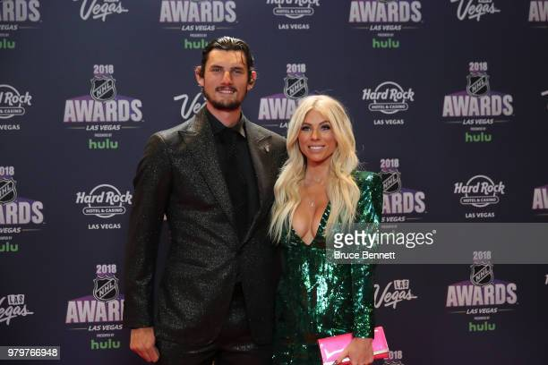 Connor Hellebuyck of the Winnipeg Jets and guest arrive at the 2018 NHL Awards presented by Hulu at the Hard Rock Hotel Casino on June 20 2018 in Las...