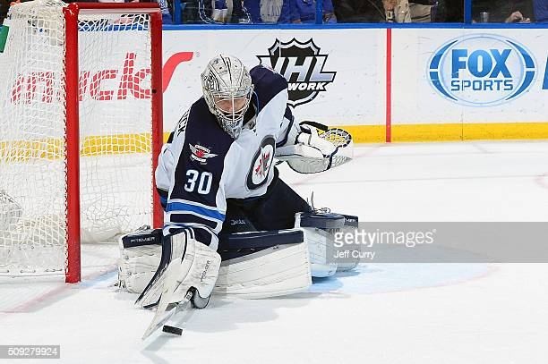 Connor Hellebuyck of the Winnipeg Jets defends the net against the St Louis Blues at the Scottrade Center on February 9 2016 in St Louis Missouri
