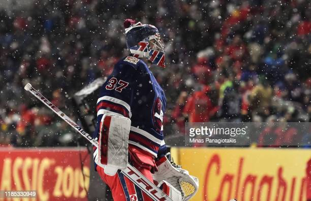 Connor Hellebuyck of the Winnipeg Jets leaves the ice at the end of the second period against the Calgary Flames during the 2019 Tim Hortons NHL...
