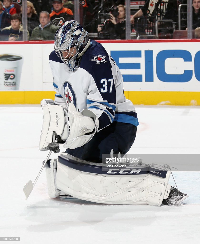 Connor Hellebuyck #37 of the Winnipeg Jets makes a glove save on a shot against the Philadelphia Flyers on March 10, 2018 at the Wells Fargo Center in Philadelphia, Pennsylvania. The Flyers went on to defeat the Jets 2-1.