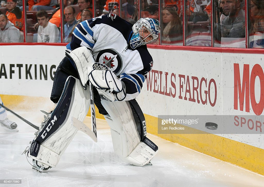 Connor Hellebuyck #37 of the Winnipeg Jets plays the puck around the boards against the Philadelphia Flyers on November 17, 2016 at the Wells Fargo Center in Philadelphia, Pennsylvania. The Flyers went on to defeat the Jets 5-2.