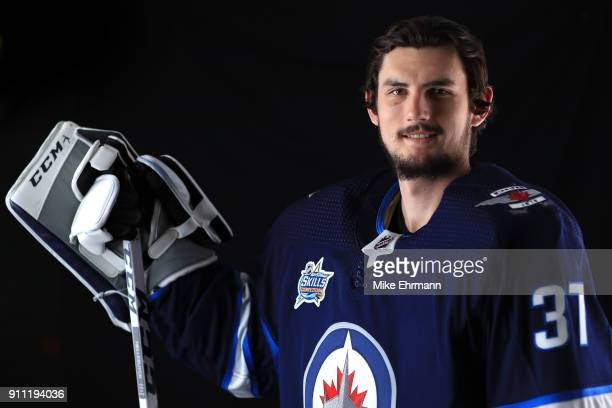 Connor Hellebuyck of the Winnipeg Jets poses for a portrait during the 2018 NHL AllStar at Amalie Arena on January 27 2018 in Tampa Florida