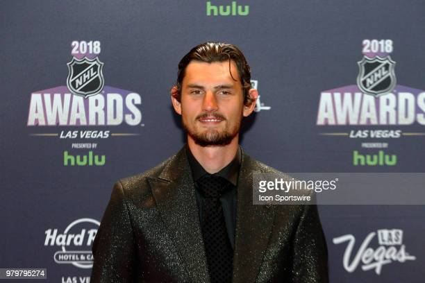 Connor Hellebuyck of the Winnipeg Jets poses for photos on the red carpet during the 2018 NHL Awards presented by Hulu at The Joint Hard Rock Hotel...