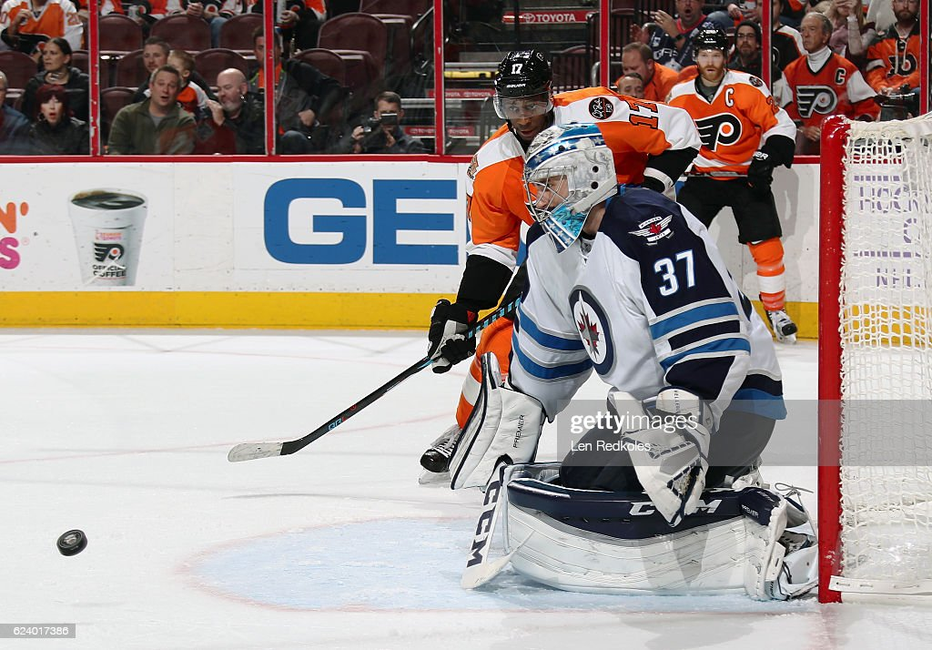 Connor Hellebuyck #37 of the Winnipeg Jets prepares to make a save as Wayne Simmonds #17 of the Philadelphia Flyers anticipates a rebound on November 17, 2016 at the Wells Fargo Center in Philadelphia, Pennsylvania. The Flyers went on to defeat the Jets 5-2.