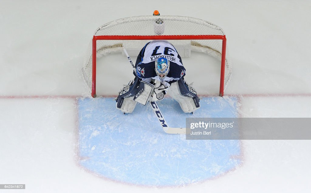 Connor Hellebuyck #37 of the Winnipeg Jets reacts after giving up a goal in the first period during the game against the Pittsburgh Penguins at PPG PAINTS Arena on February 16, 2017 in Pittsburgh, Pennsylvania.