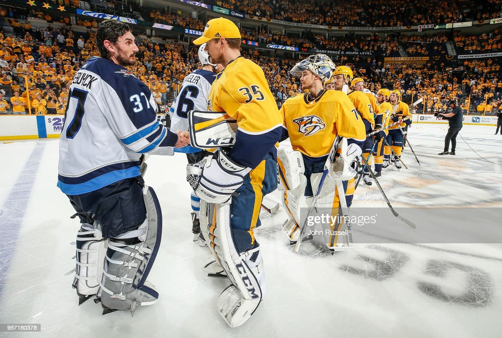 Connor Hellebuyck #37 of the Winnipeg Jets shakes hands with Pekka Rinne #35 of the Nashville Predators in Game Seven of the Western Conference Second Round during the 2018 NHL Stanley Cup Playoffs at Bridgestone Arena on May 10, 2018 in Nashville, Tennessee.
