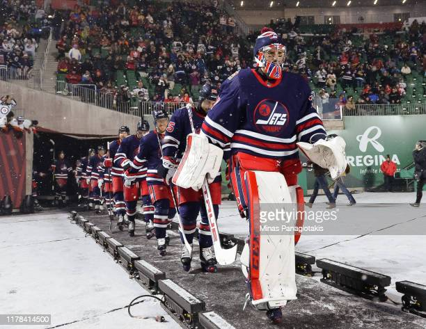 Connor Hellebuyck of the Winnipeg Jets walks to the ice for the second period against the Calgary Flames during the 2019 Tim Hortons NHL Heritage...
