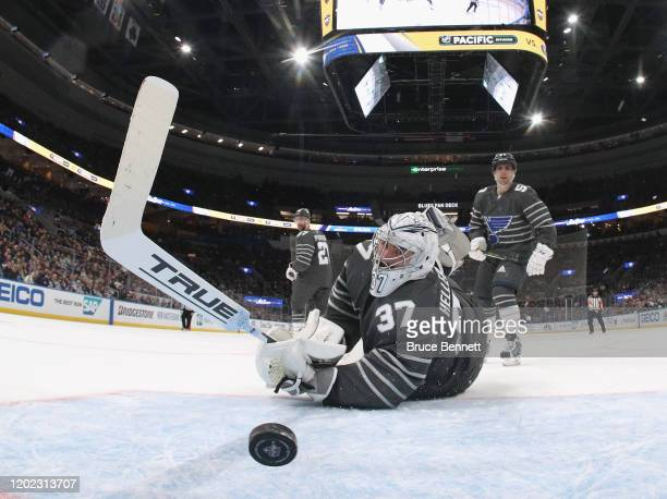 Connor Hellebuyck of the Winnipeg Jets watches Atlantic Division All-Stars puck get past him in the game between Pacific Division and Central...