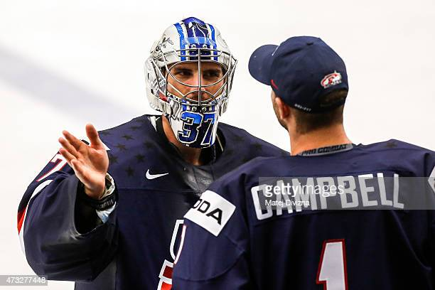Connor Hellybuyck , goalkeeper of USA, speaks with his team-mate Jack Campbell during the IIHF World Championship quaterfinal match between USA and...
