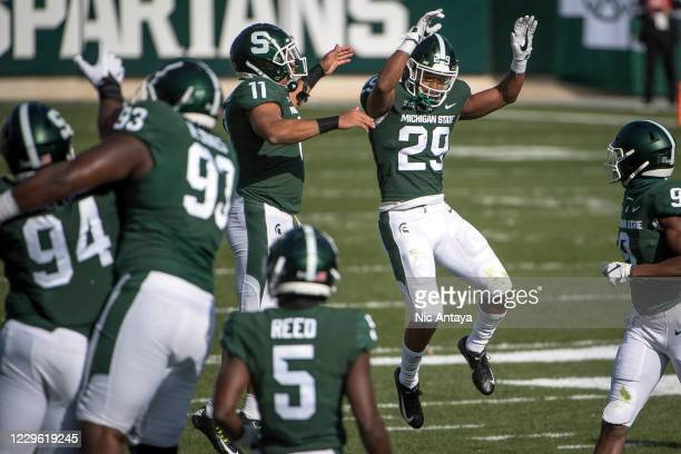 Connor Heyward of the Michigan State Spartans and Shakur Brown of the Michigan State Spartans celebrate Browns interception at Spartan Stadium on...