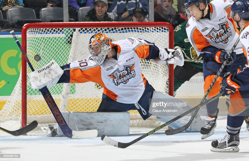 Connor Hicks #50 of the Flint Firebirds makes a big stop against the London Knights during an OHL game at Budweiser Gardens on March 17, 2017 in London, Ontario, Canada. The Knights defeated the Firebirds 7-3.
