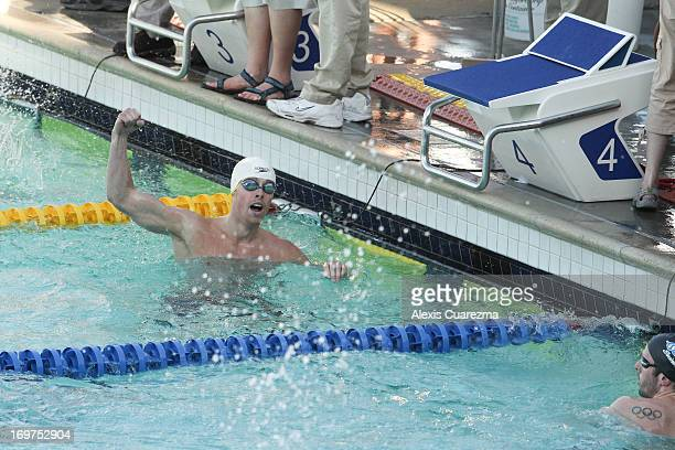 Connor Jaeger celebrates after winning the men's 400 meter free style during Day Two of the Santa Clara International Grand Prix at the George F...